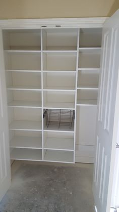 White Melamine Pantry With Adjustable Shelves And Pull Out Wire Basket.