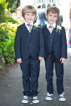 Very smart page boys in navy suits. Love the sneakers!  From 'An Elegant Summer Time and Vintage Inspired Gaynes Park Wedding'.  Photography by http://www.dominicwhiten.co.uk/ #weddingring
