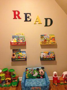 Bookshelf wall made with spice racks from Ikea I painted.