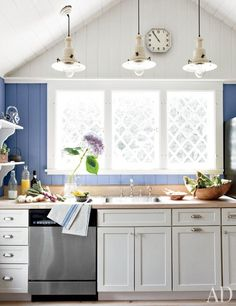 A bright kitchen featuring a gabled ceiling | archdigest.com