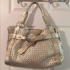 Silver Leather Woven Shoulder Bag Silver hardware.  Rivets.  Snap closure. 5 interior pockets (2 zip).  Measures: 15x3.5x10.5x7.5.  Leather. Great condition. Independent Designer Bags Shoulder Bags