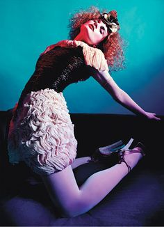 Chanel's organza dress. M&S Schmalberg Inc. flowers; Cornelia James gloves; Falke hosiery; Yves Saint Laurent shoes.  Photographs by Mario Sorrenti  Styled by Edward Enninful  March 2012