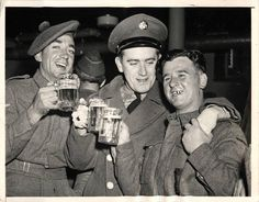 1942- British soldiers of the 4th Battalion Queens Own Cameron Highlanders, stationed at a U.S. post, shown drinking beer with American soldier at post canteen in New York.