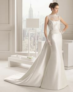 Love everything about this wedding dress!  From the sheer front, the flowing lines of the skirt and train.  Design by Rosa Clara.    12 Stunning #Designer #Wedding #Dresses
