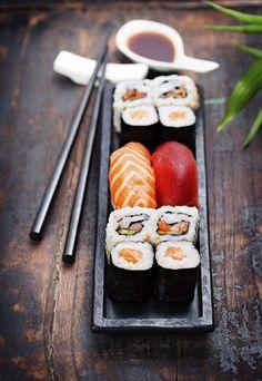 sushi with chopsticks by Natalia Klenova Photograp on Sushi Burger, Sushi Lunch, Sushi Party, My Sushi, Sushi Restaurants, Making Sushi Rolls, Sushi Ingredients, Sushi Donuts, Sushi Platter