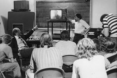 1979: John Williams (pointing at TV) discusses his score for Jaws to a classroom of Berklee students, as the school launches the first degree program in film scoring.