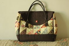 https://flic.kr/p/99BKBF | quilted handmade patchwork vintage bag for myself. | This bag was supposed to be completed by mid of last year but due to the leather holder !!!  I ended up completed it in December.  I cannot find any suitable leather holder here at my school, my dear friend brought it for me from Japan early December.   I collected quite a lot of retro vintage accessories, it is just perfect to add some simple touch up to the front of my bag, see....  blogged…