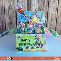 (at the end of my post I share how I store & transport my Copic markers!) Eek! I think I'm in love! Today I broke out my new Lawn Fawn Scalloped Box Card Pop-Up Cut Set and created an oober-fun birthday pop-up box! If you haven't seen this die and how it works, here is Lawn Fawn's video: Isn't …