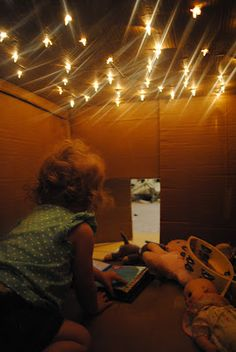 Box of stars! stab a box with scissors to make holes, poke Christmas lights through, and crawl in. super fun play spot!
