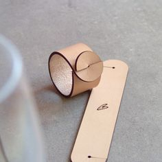 INSPIRATION - Leather napkin ring by Skandinavious Would be cute as a bracelet too.