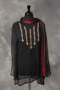 Black chiffon with gold and red embroidery, and white and gold stones.