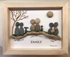 Pebble art family. Driftwood, moss and a tree.