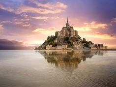 Rising up from vast sandbanks and powerful tides, the rocky island of Mont Saint-Michel gives off an otherworldly appearance in its position off France's northwestern coast in Normandy. A small medieval village, complete with winding streets and tiny houses, sits on the island, but the crown jewel is undoubtedly the Abbey of Mont Saint-Michel. The incredibly abbey was build in 708 A.D., and was the inspiration behind the castle in Disney's Tangled.