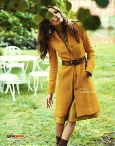 Gold coat from J. Crew's upcoming Fall collection. I would bet Mittens that it's pinned tight in the back though. J. Crew coats never fit this slim at the waist.