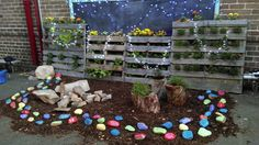Added painted rocks with haiku written by students
