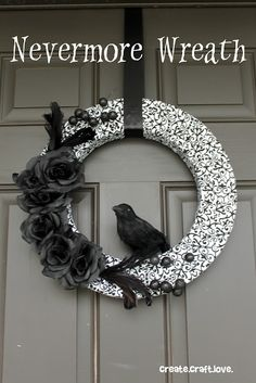 Black and White Halloween Wreath. With rosettes & crow. Door & porch decorations & decorating ideas. DIY front door decoration & ideas for decorating your front porch.
