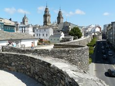 Discover Roman Walls of Lugo in Lugo, Spain: Remarkably intact Roman stone fortifications have encircled this Spanish city for centuries. Portugal, Fortification, Pilgrimage, European Travel, Homeland, Places Ive Been, Spanish, Beautiful Places, Places To Visit