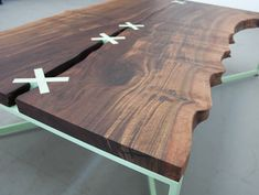 Stitch table by Uhuru Design, a flitch-cut hardwood slab stitched with recycled plastic.