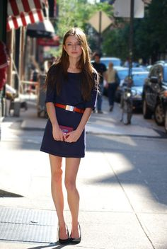 Trend: simple navy dress with sleeves and bright red belt