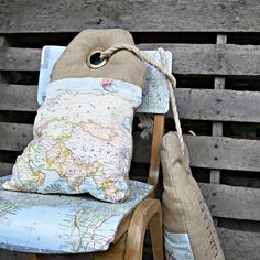 Personalized map burlap pillows to look like luggage tags  and map chair both tutorials on Pillarboxblue.com