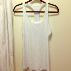 White Nike Dri-fit tank Great condition! No rips, tears or stains Nike Tops Tank Tops