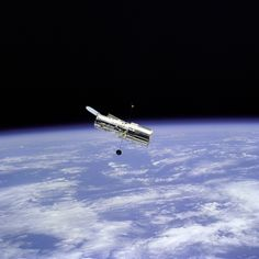 Flyaround of the Hubble Space Telescope (HST) after deployment on this second servicing mission (HST SM-02). Note the telescope's open aperature door. (Great Images in NASA)