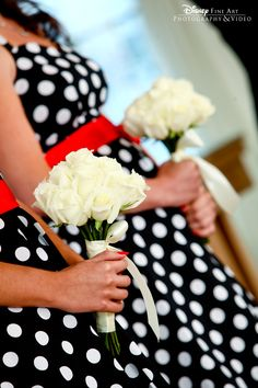 These bridesmaids rocked adorable black and white polka dot dresses with red sashes and white rose bouquets!