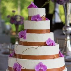 The buttercream-frosted cake was topped with radiant orchids and curly-willow branches.