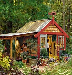 Trimmed with cedar shake siding and a cozy porch, this handy shed's exterior exudes rustic charm. Skylights fill the interior with natural light and warmth, making it a great work environment for all your hobbies.  Love this!!