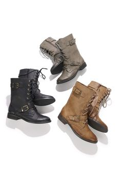 Combat boots with a lace-up front, buckles, and an easy side zipper.