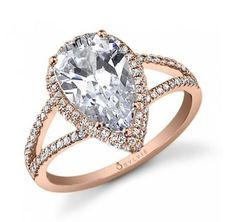 Vintage Split Shank Pear Diamond Engagement Ring This stunning rose gold diamond engagement ring features a 1 carat pear shaped center with a total of 0.37 carats in a halo and split shank for a ring with vintage style.