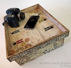 a charging station decorated with scrapbook paper  should use graphic 45