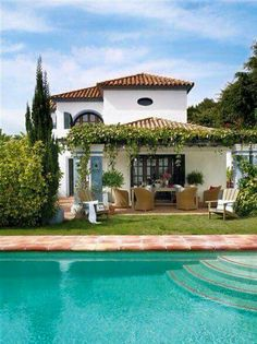 Spanish style home with a flowering ivy-covered pergola and jaw-dropping turquoise pool. - One Kings Lane - - Spanish style home with a flowering ivy-covered pergola and jaw-dropping turquoise pool. - One Kings Lane
