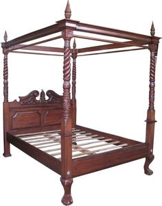 Reproduction Queen Anne style four poster bed with canopy by Lock Stock and Barrel Furniture. This bed is hand carved with intricate detailing and features poles suitable for hanging drapes. It is ideal for that special bedroom.