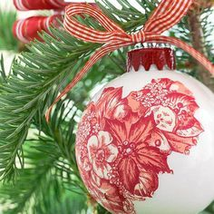 A piece of toile pattern trimmed from a dinner napkin and decoupaged onto a basic ball becomes an elegant ornament./