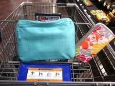 This is how I roll! Coupon shopping with my Thirty-One Coupon Clutch paired with my Thirty-One Pocket-A-Tote.  The Thirty-One Pocket-A-Tote hooks very nicely to the cart to help keep your grocery list and coupons organized!    I love shopping in style..... Thirty-One style!