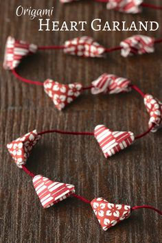This origami heart garland is perfect for Valentine's Day or weddings. Make tiny 3D kirigami hearts and string them on embroidery floss.
