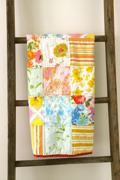 A patchwork quilt made from vintage bed sheets.
