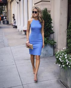Mary Orton looking city chic, wearing the Bi-Stretch Racer-Neck Sheath Dress. Expert tailoring and our bi-stretch fabric  instantly refine and sculpt your figure, and the gorgeous blue shade is perfect for summer. Pair with neutral heels and a clutch for even more sophistication.