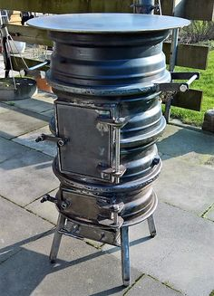 """Receive terrific recommendations on """"outdoor fire pit ideas backyards"""". They are readily available for you on our web site. Rim Fire Pit, Fire Pit Grill, Fire Pit Backyard, Wheel Fire Pit, Diy Wood Stove, Portable Fire Pits, Fire Pit Furniture, Fire Pit Designs, Wood Burner"""