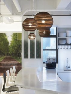 After: Stunning lighting by Graypants adds texture and intrigue to the cafe.    Photo courtesy of Eric Laignel.