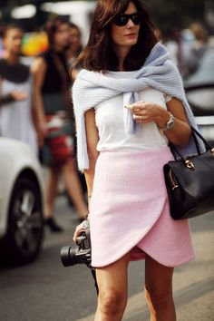 Fall on the street.....pink skirt(not normally a fall color, but the cut and texture works here), white shirt, sweater (neutral color)...nice bag and...a serious camera..might as well be stylish while you're shooting.