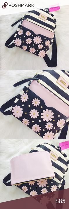 Betsey Johnson Flower Stripe Backpack Such a gorgeous backpack, cute flower & pearl design on half the front outer pocket, removable light pink pouch/wallet, spacious interior with key/phone holder/pockets, interior zipper pocket, exterior side pockets. Measurements are 13.5x10.5x5. New with tags. Betsey Johnson Bags Backpacks