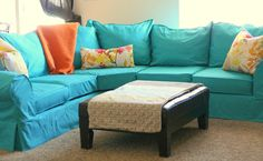 turquoise couch slipcover   First AFTER--- we thought her current pillows would match and work ...