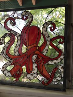 North Pacific Octopus possesses a magical flow of movement throughout the glass … - Cool Glass Art Designs Stained Glass Angel, Stained Glass Flowers, Stained Glass Crafts, Faux Stained Glass, Stained Glass Windows, Mosaic Windows, Broken Glass Art, Sea Glass Art, Glass Wall Art