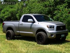 This 2007 Toyota Tundra is running Ballistic Rage wheels Fury Offroad Country Hunter Rt tires with Rough Country Leveling Kit suspension. 2007 Toyota Tundra, Toyota 4x4, Toyota Trucks, Custom Pickup Trucks, Suv Trucks, 2007 Tundra, Wheels And Tires, Hot Wheels, Single Cab Trucks