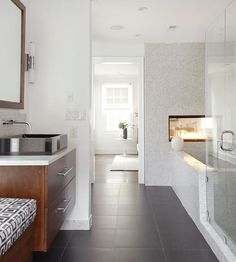 Natural light and small marble tiles make this pretty bath spa-like. See the rest of this dreamy bath here: http://www.bhg.com/bathroom/decorating/dream/elegant-bathroom-decorating-ideas/?socsrc=bhgpin071612spalikebath#page=15