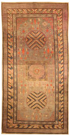 A Samarkand rug BB4119 - A decorative early 20th century Samarkand antique rug, the abrashed sage field with floral motifs and vases around ...