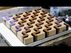 Check out this amazingly convincing 3D illusion end grain cutting board. I LOVE this!