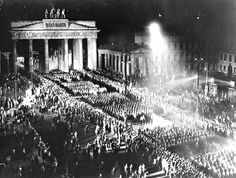 "Members of the SA, the paramilitary wing of the Nazi Party also known as the ""brownshirts,"" march with torches near Berlin's Brandenburg Gate on Jan. 30, 1933 to celebrate Hitler's taking power that day."